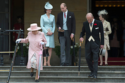The Duke and Duchess of Cambridge (centre), Queen Elizabeth II and the Duke of Edinburgh and the Princess Royal at a garden party at Buckingham Palace in London.