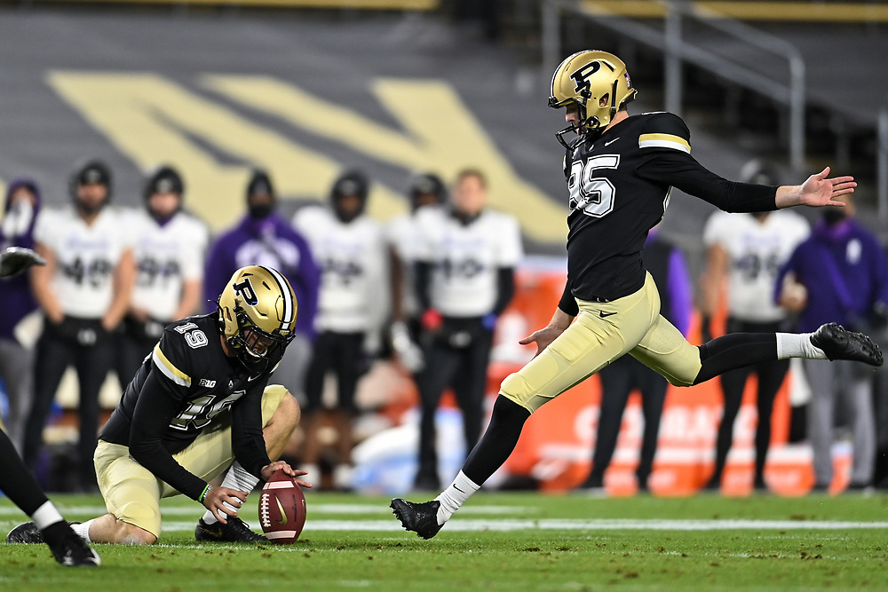 November 14, 2020:  Purdue kicker J.D. Dellinger (85) kicks field goal out of the hold by Purdue punter Brooks Cormier (19) during NCAA football game action between the Northwestern Wildcats and the Purdue Boilermakers at Ross-Ade Stadium in West Lafayette, Indiana. Northwestern defeated Purdue 27-20.  John Mersits/CSM.