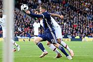 Scotland midfielder Callum McGregor (11) (Celtic)  and Portugal midfielder Sergio Oliveira (15) (Porto)  during the Friendly international match between Scotland and Portugal at Hampden Park, Glasgow, United Kingdom on 14 October 2018.