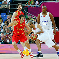 08 August 2012: France Tony Parker drives past Jose Calderon during 66-59 Team Spain victory over Team France, during the men's basketball quarter-finals, at the 02 Arena, in London, Great Britain.