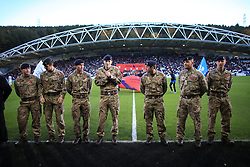 4th November 2017 - Premier League - Huddersfield Town v West Bromwich Albion - Members of the armed forces try to stay warm as they wait on the side of the pitch ahead of Remembrance Day proceedings at The John Smith's Stadium - Photo: Simon Stacpoole / Offside.