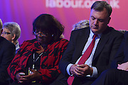© Licensed to London News Pictures. 03/10/2012. Manchester, UK Diane Abbot and Ed Balls look at their mobile phones on Day 4 at The Labour Party Conference at Manchester Central today 3rd october 2012. Photo credit : Stephen Simpson/LNP
