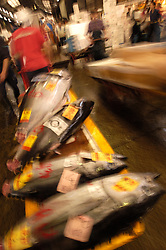 Transporting barrow of fresh tuna at Tsukiji fish Market in Tokyo motion blurr