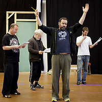 """Picture shows : Paul Riley as Fran, Jimmy Chisolm as Simon,  Greg Hemphill as Finlay and Sean Biggerstaff as Rory  during the rehearsals of the forthcoming National Theatre of Scotland production 'An Appointment with The Wicker Man'..Picture © Drew Farrell  ( Tel : 07721-735041 ).On a remote Scottish island, the Loch Parry Theatre Players mount their am-dram version of The Wicker Man. When their lead actor goes missing in mysterious circumstances, they call on the services of a television cop from the mainland to step in and save their production. ..The play opens at the MacRobert Arts Centre, Stirling on 18th February 2012 before touring Aberdeen, Glasgow, Inverness and Dunfermline...The Wicker Man regularly tops """"Best Horror Film of All Time"""" lists and is regarded as a true film classic. With an unforgettable sense of creeping dread, a wonderfully memorable score by Paul Giovanni, career defining performances from Edward Woodward and Christopher Lee it also has arguably the best ending in cinema history. Now, in an affectionate new adaptation, the National Theatre of Scotland gives a gallus round of applause to this immortal chronicle of strange goings-on in a wee village. ..An Appointment with the Wicker Man features Greg Hemphill (Chewin' the Fat) and Johnny McKnight (Little Johnny's Big Gay Wedding) alongside a line-up of comic talent. It is at once a deliciously wicked homage to, and a tender celebration of, a piece of cinema history that reveals for us the spooky undercurrents lurking just below the surface of Scottish village life. ..The Loch Parry Players are messing with forces they can't possibly comprehend but at the end of the night, only one thing is for sure . . . someone's going to burn for this...Cast..Sean Biggerstaff    as       Howie and Rory.Jimmy Chisolm      as       Simon.Greg Hemphill        as     Finlay.Johnny McKnight   as      Callum.Sally Reid                 as      Marie.Paul Riley.         as      Fran.Ros Sydne"""