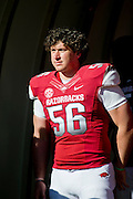 Nov 23, 2012; Fayetteville, AR, USA; Arkansas Razorbacks defensive end Will Coleman (56) waits to be recognized for Senior Day before a game against the Louisiana State Tigers at Donald W. Reynolds Stadium.  LSU defeated Arkansas 20-13. Mandatory Credit: Beth Hall-US PRESSWIRE