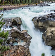 Lower Sunwapta Falls, in Jasper National Park, Canadian Rockies, Alberta, Canada. Jasper is the largest national park in the Canadian Rocky Mountain Parks World Heritage Site declared by UNESCO in 1984. This panorama was stitched from 3 overlapping images.