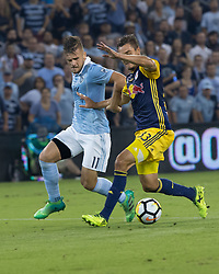 September 20, 2017 - Kansas City, Kansas, U.S - Sequence 02-02: NY Red Bulls defender Aaron Long #33 (r) vies against the offense of Sporting KC forward Diego Rubio #11 (l) during the first half of the game. Sporting KC will win the 2017 Lamar Hunt Open Cup championship with a score of 2-1 over the New York Red Bulls. (Credit Image: © Serena S.Y. Hsu via ZUMA Wire)