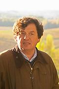 Comte (count) Laurent de Bosredon, owner of Chateau Belingard standing in front of his vineyard in autumn evening sunshine Chateau Belingard Bergerac Dordogne France