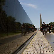 Visitors to the Vietnam War Memorial located along the National Mall in Washington DC.