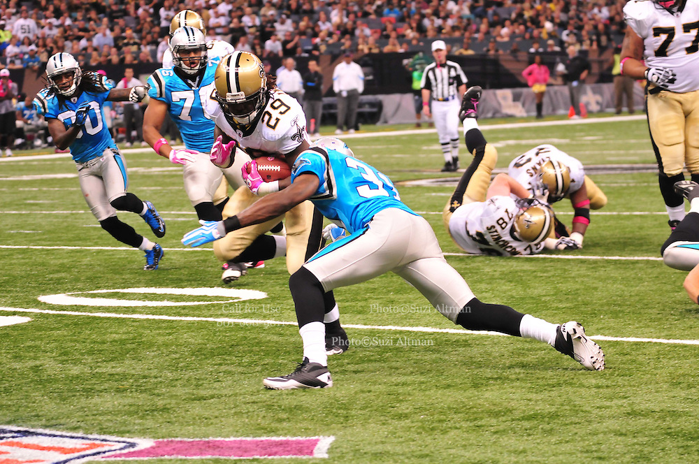 """New Orleans Saints RB Chris Ivory breaks a tacklem then takes a hard hit and fumbles the ball during the game against the Carolina Panthers Sunday Oct. 3,2010. The NFL has gone """"Pink"""" for October in honor of Breast Cancer Awareness. The Saints went on to win 16-14. John Carney kicked three field goals to help the Saints win. PHOTO©SuziAltman.com"""