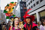New York, NY - 21 April 2019. A couple with elaborate hats at the Easter Bonnet Parade and Festival on New York's Fifth Avenue.