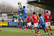 Charlton Athletic goalkeeper Ben Amos (1) saving from AFC Wimbledon defender Jon Meades (3) and AFC Wimbledon defender Darius Charles (32) during the The FA Cup match between AFC Wimbledon and Charlton Athletic at the Cherry Red Records Stadium, Kingston, England on 3 December 2017. Photo by Matthew Redman.