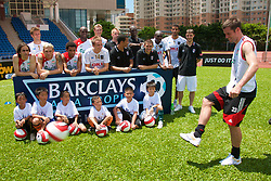 Hong Kong, China - Wednesday, July 25, 2007: Liverpool's Jamie Carragher with plays from Portsmouth and Fulham during a coaching session with local children at the Siu Sai Wan Sports Ground in Hong Kong. (Photo by David Rawcliffe/Propaganda)