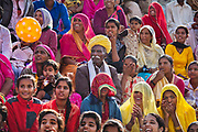Spectators in traditional Rajasthani clothing at the Desert Festival on 29th January 2018  in Jaisalmer, Rajasthan, India. It is an annual event that take place in February month in the beautiful city Jaisalmer. It is held in the Hindu month of Magh February, three days prior to the full moon.