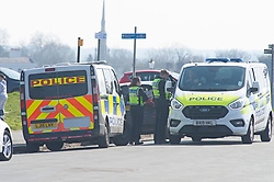 ©Licensed to London News Pictures 26/03/2020<br /> Greenwich, UK. Police parked up outside the gates to Greenwich Park. People get out and about in Greenwich Park, Greenwich, London this afternoon as they make the most of their permitted one a day exercise out of the house from Coronavirus Lockdown. The Prime Minister Boris Johnson has asked people to stay at home to help in the fight against Covid-19. Photo credit: LNP