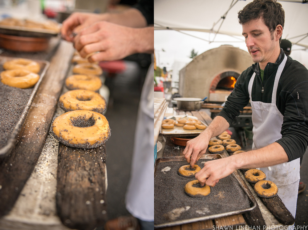 Sean Hickey making wood fired sesame bagels at the Tastebud booth on opening day of Green Zebra Grocery