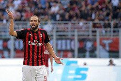 October 7, 2018 - Milan, Milan, Italy - Gonzalo Higuain #9 of AC Milan reacts to a missed chance during the serie A match between AC Milan and Chievo Verona at Stadio Giuseppe Meazza on October 7, 2018 in Milan, Italy. (Credit Image: © Giuseppe Cottini/NurPhoto/ZUMA Press)