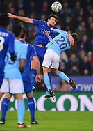 Harry Maguire of Leicester city and Bernardo Silva of Manchester City jump for the ball  .Carabao Cup quarter final match, Leicester City v Manchester City at the King Power Stadium in Leicester, Leicestershire on Tuesday 19th December 2017.<br /> pic by Bradley Collyer, Andrew Orchard sports photography.