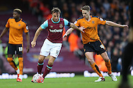 Mark Noble, the West Ham United captain is challenged by Dave Edwards of Wolverhampton Wanderers. The Emirates FA cup, 3rd round match, West Ham Utd v Wolverhampton Wanderers at the Boleyn Ground, Upton Park  in London on Saturday 9th January 2016.<br /> pic by John Patrick Fletcher, Andrew Orchard sports photography.