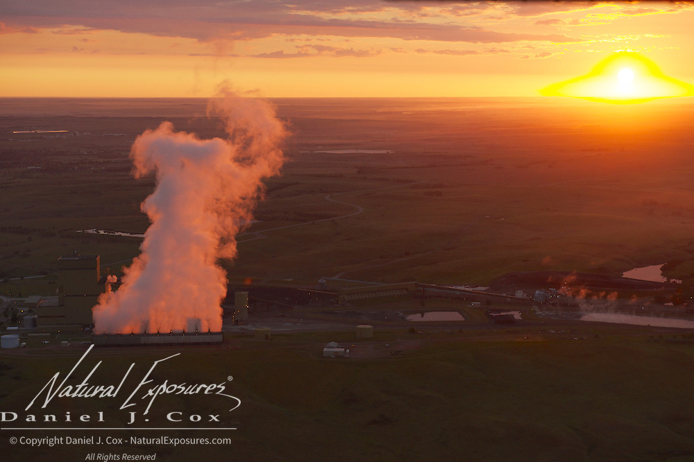 Steam rises from the water cooling tanks of a coal fired power plant in North Dakota