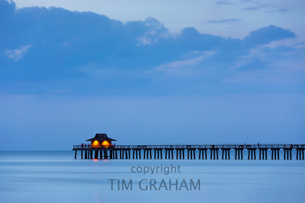 The pier at Naples beach at sunset in Florida, United States of America