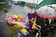 Anti-fracking activists try to block the entrance to Quadrillas drill site in New Preston Road, July 04 2017, Lancashire, United Kingdom. The blockade is a repsonse to the emmidiate drilling for shale gas, fracking, by the fracking company Quadrilla and part of an ongoing struggle where makeshift towers and makeshift camps have sprung up outside the premisses. Lancashire voted against permitting fracking but was over ruled by the conservative central Government. All the activists have been active in the struggle against fracking for years but this is their first direct action of peacefull protesting. Fracking is a highly contested way of extracting gas, it is risky to extract and damaging to the environment and is banned in parts of Europe . Lancashire has in the past experienced earth quakes blamed on fracking.