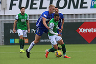 Christian Doidge (9) of Hibernian is fouled during the Betfred Scottish League Cup match between Cove Rangers and Hibernian at Balmoral Stadium, Aberdeen, Scotland on 10 October 2020.