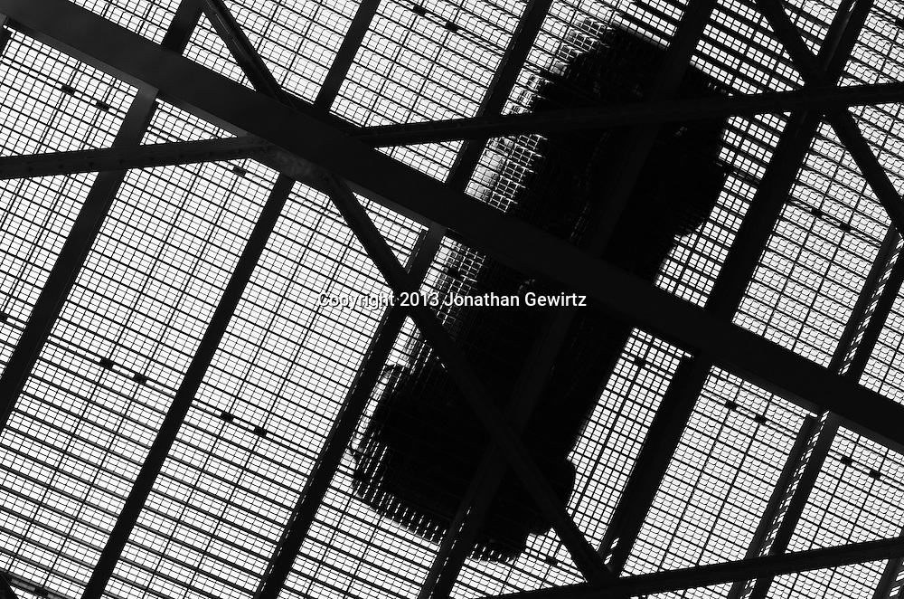 Black and white view from underneath of a car crossing a metal drawbridge. WATERMARKS WILL NOT APPEAR ON PRINTS OR LICENSED IMAGES.
