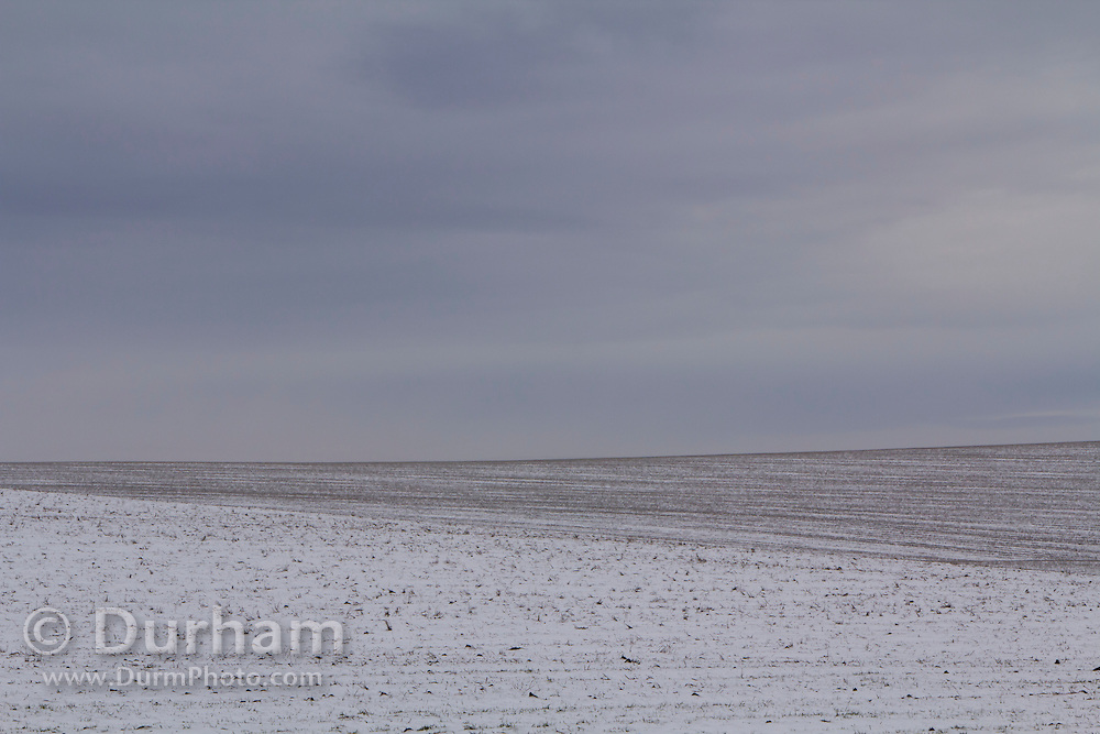 A thin layer of snow on a field in Central Oregon.