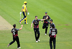 Jamie Overton of Somerset celebrates with teammates after taking the wicket of James Vince of Hampshire - Mandatory by-line: Robbie Stephenson/JMP - 19/06/2016 - CRICKET - Cooper Associates County Ground - Taugnton, United Kingdom - Somerset v Hampshire - NatWest T20 Blast