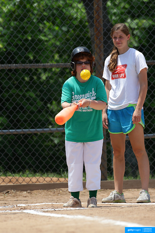 A batter at the plate getting a hit during the Norwalk Little League baseball 'Champions' team V Greenwich in the Challenger Division  Recognition Day competition. The day acknowledged the many talents of the great players on the Challenger Division teams. The division has weekly games and practices for kids with special needs. Challenger division are held throughout the country.  Broad River Fields, Norwalk, Connecticut. USA. 2nd June 2013. Photo Tim Clayton