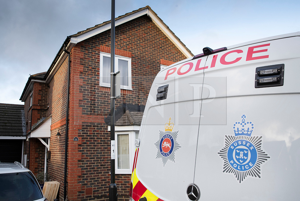 © Licensed to London News Pictures. 22/12/2018. Crawley, UK. Police vehicles are seen outside a property in Crawley. Is is not clear if this is in connection with the couple detained by police over the Gatwick drone attacks. Photo credit: Peter Macdiarmid/LNP
