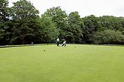 Bowling match at Norfolk Park on 9 June 2017 in Sheffield, United Kingdom.  Bowls or lawn bowls is a sport in which the objective is to roll balls so that they stop close to a smaller ball called a jack or kitty. It is played on a bowling green normally outdoors and on natural grass