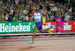 Great Britain's Nethaneel Mitchell-Blake on his way to winning gold in the Men's 4x100m Relay Final during day nine of the 2017 IAAF World Championships at the London Stadium. Picture date: Saturday August 12, 2017. See PA story ATHLETICS World. Photo credit should read: Martin Rickett/PA Wire. RESTRICTIONS: Editorial use only. No transmission of sound or moving images and no video simulation.