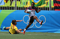 August 11, 2016; Rio de Janeiro, Brazil; USA Men's Eagles Sevens Carlin Isles breaks through the Spanish defense during the Men's Rugby Sevens 9th Place Final match on Day 4 of the Rio 2016 Olympic Games at Deodoro Stadium. Photo credit: Abel Barrientes - KLC fotos
