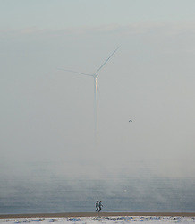© Licensed to London News Pictures. 17/01/2013..South Gare, Teesside, England..An ice cold winter fog blankets an area known as South Gare on Teesside shrouding the offshore wind farm...Photo credit : Ian Forsyth/LNP