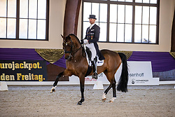 Kronberg, Gestüt Schafhof, KRONBERG _ Int. Festhallen Reitturnier Schafhof Edition 2020<br /> <br /> KITTEL Patrik (SWE), Touchdown 10<br /> NÜRNBERGER BURG-POKAL der Dressurreiter 2020 - Einlaufprüfung <br /> Prix. St. Georges Special für 7-9j. Pferde <br /> Dressurprüfung Kl. S*<br /> <br /> 19. December 2020<br /> © www.sportfotos-lafrentz.de/Stefan Lafrentz