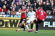 Wayne Routledge of Swansea city © tries to go past Matteo Darmian (l) and Marcos Rojo of Manchester Utd.   Premier league match, Swansea city v Manchester Utd at the Liberty Stadium in Swansea, South Wales on Sunday 6th November 2016.<br /> pic by  Andrew Orchard, Andrew Orchard sports photography.
