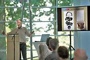 Nederland, Nijmegen, 26-6-2020  In museum het Valkhof werd vandaag een klein deel van een belangrijke archeologische vondst getoond. Het gaat om een Keltisch wagengraf, gevonden in de gemeente Heumen met veel metalen objecten . Een deel daarvan is nog in restauratie en conservatie . De resten zijn ontdekt door amateurbodemonderzoekers die met metaal detectoren de grond aftasten. Ze waren daarna illegaal opgegraven en slecht behandeld. Toch zijn ze opgedoken en overgedragen aan het Rijk . Nico Roymans van de VU .Foto: Flip Franssen