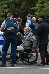 March 15, 2019 - Christchurch, Canterbury, New Zealand - Witness's and Police at the South end of Deans Avenue after a shooting incident resulting multiple fatalities and injuries at the Masjid Al Noor Mosque in Deans Avenue, Christchurch, New Zealand. At least 49 people were killed and 20 seriously injured in mass shootings at two mosques in the New Zealand city of Christchurch. 48 people, including young children with gunshot wounds, were taken to hospital. Three people were arrested in connection with the shootings. (Credit Image: © David Alexander/SNPA via ZUMA Wire)