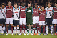 French and Tottenham goalkeeper Hugo Lloris © is visibly moved as both sets of players stand together whilst the national anthem of France is played out in a mark of respect to the Paris attacks before k/o  Barclays Premier league match, Tottenham Hotspur v West Ham Utd at White Hart Lane in London on Sunday 22nd November 2015.<br /> pic by John Patrick Fletcher, Andrew Orchard sports photography.