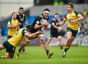New Zealand flanker Luke Jacobson is held by Australia full-back Jack Maddocks during the World Rugby U20 Championship 5rd Place play-off  match Australia U20 -V- New Zealand U20 at The AJ Bell Stadium, Salford, Greater Manchester, England on Saturday, June  25  2016.(Steve Flynn/Image of Sport)