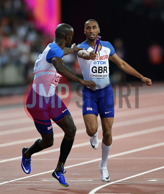Matthew Hudson-Smith of Great Britain hands the baton to team-mate Dwayne Cowan - Mandatory byline: Patrick Khachfe/JMP - 07966 386802 - 13/08/2017 - ATHLETICS - London Stadium - London, England - Men's 4x400m Metres Relay Final - IAAF World Championships