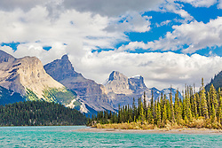 The Queen Elizebeth Range escaping from the depths of Jasper Park's Maligne Lake.
