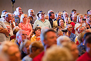 14 SEPTEMBER 2011 - SUN LAKES, AZ: The crowd listens to Mitt Romney in the Oakwood Clubhouse at Sun Lakes Wednesday. Romney was one of the first of the 2012 Republicans running for the GOP Presidential nomination to come to Arizona. He campaigned Wednesday in Tucson and Sun Lakes and attended a private event in Tempe.     PHOTO BY JACK KURTZ