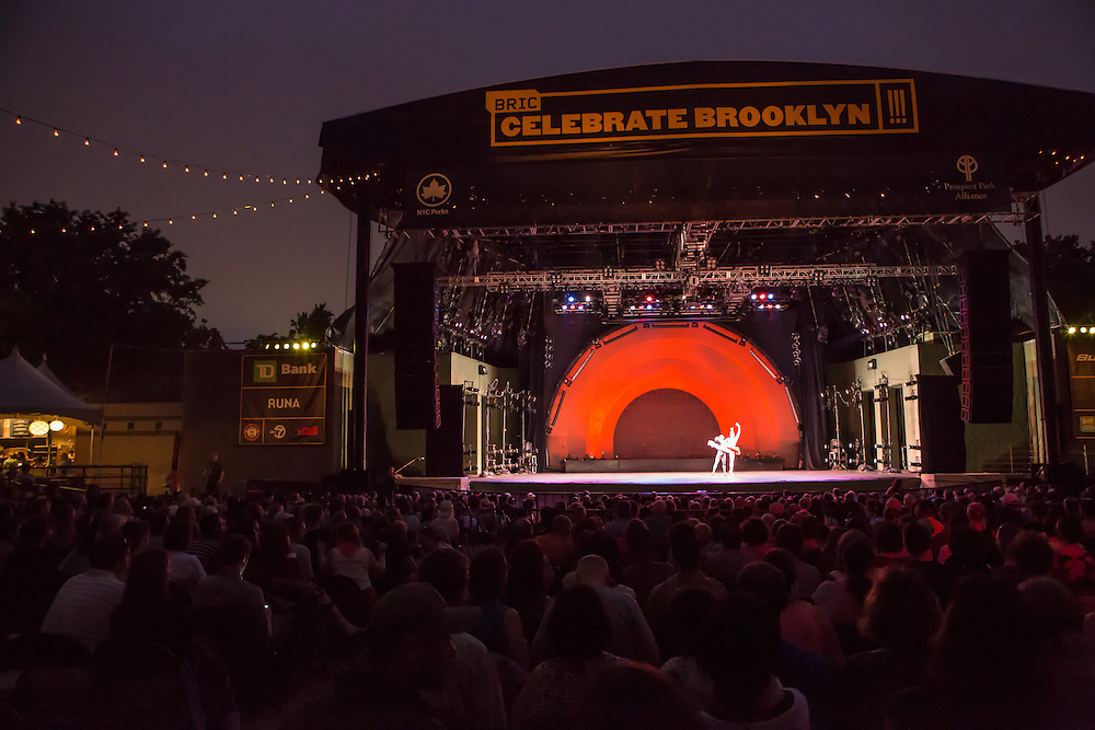 Two dancers from Les Ballets Trockadero de Monte Carlo take the stage after dusk at the Prospect Park bandshell for this performance in the Celebrate Brooklyn series.