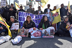© Licensed to London News Pictures. 14/03/2018. LONDON, UK.  Kurdish supporters stage a demonstration in the road outside the Houses of Parliament protesting about Turkish oppression of Kurds in the city of Afrin.  Photo credit: Stephen Chung/LNP