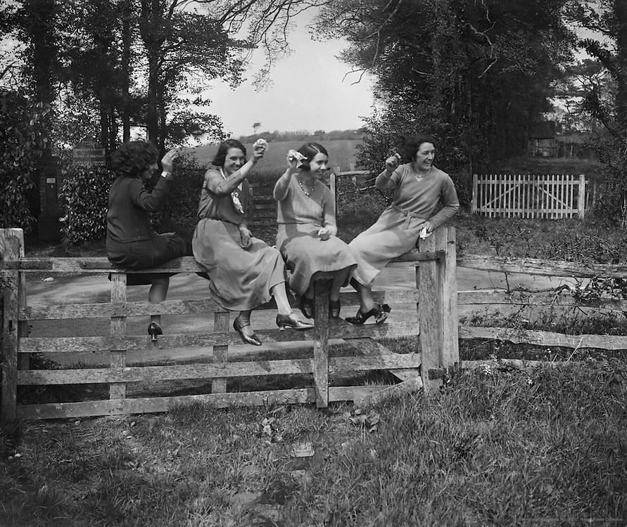 Three Women Sitting on a Gate, England, 1932