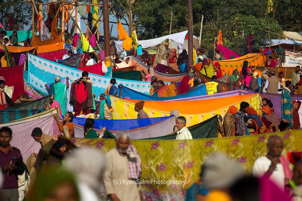 Groups of Hindu pilgrims air dry their sari's after an auspicious dip the holy Ganges during the Kumbh Mela. Kumbh mela