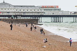© Licensed to London News Pictures. 16/06/2019. Brighton, UK. A near empty beach in Brighton and Hove as rain and colder weather is hitting the seaside resort. Photo credit: Hugo Michiels/LNP